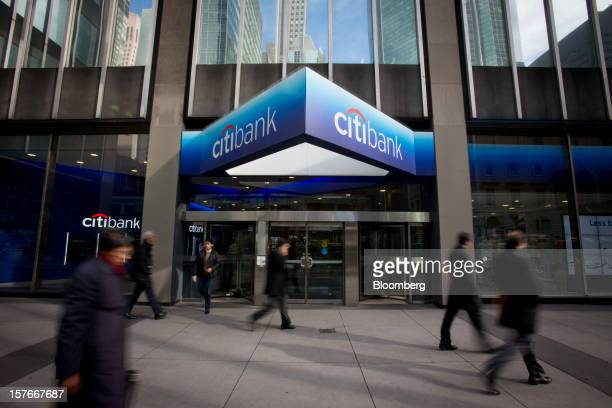 Pedestrians walk past a Citibank branch located adjacent to Citigroup Inc headquarters in New York US on Thursday Sept 20 2012 Citigroup Inc Chief...