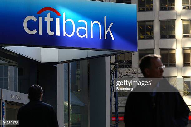 Pedestrians walk past a Citibank branch located in the headquarters of Citigroup Inc in New York US on Monday Nov 17 2008 Citigroup Inc the US bank...
