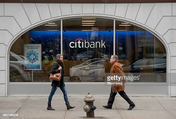 Pedestrians walk past a Citigroup Inc Citibank branch in New York US on Monday Dec 8 2014 US stocks dropped following the worst loss in six weeks for...
