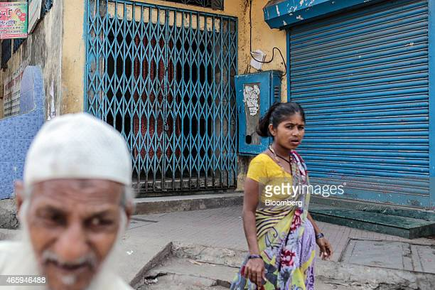 Pedestrians walk past a closed beef store in Mumbai India on Tuesday March 10 2015 The government of the state of Maharashtra last week banned...