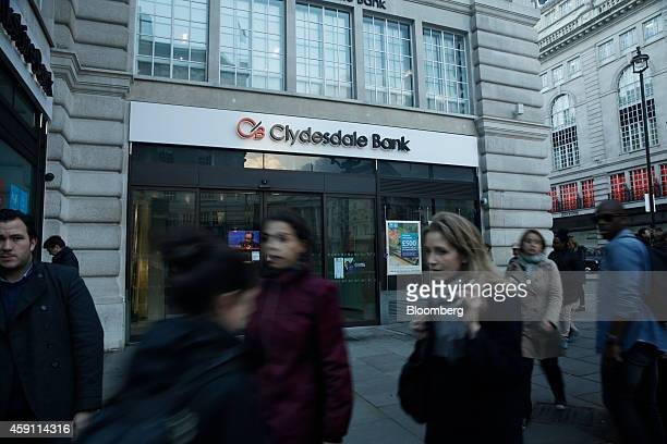 Pedestrians walk past a Clydesdale Bank Plc branch owned and operated by National Australia Bank Ltd in London UK on Friday Nov 14 2014 National...