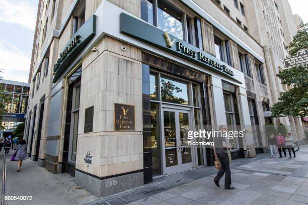 Pedestrians walk past a First Republic Bank branch in downtown Boston Massachusetts US on Tuesday Oct 10 2017 First Republic Bank is scheduled to...