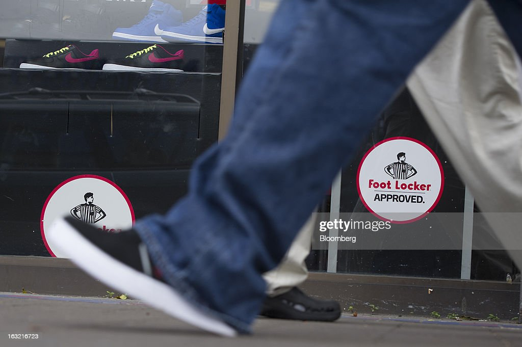 Pedestrians walk past a Foot Locker Inc. store in San Francisco, California, U.S., on Tuesday, March 5, 2013. Foot Locker Inc. is expected to release earnings data on March 8. Photographer: David Paul Morris/Bloomberg via Getty Images