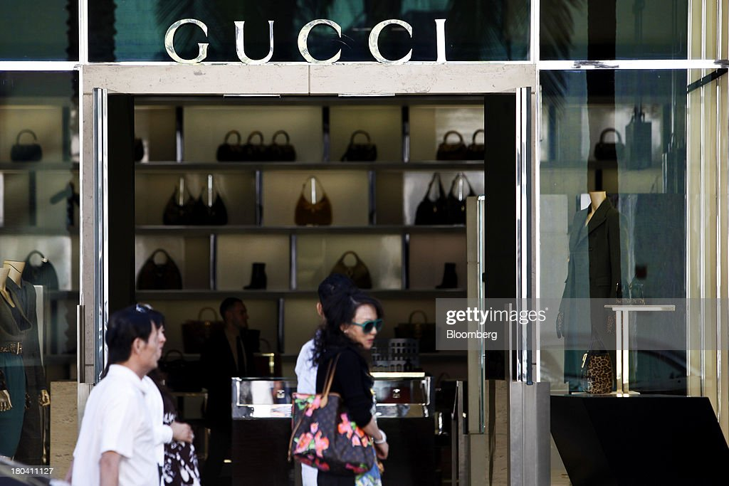 Pedestrians walk past a Gucci store on Rodeo Drive in Beverly Hills, California, U.S., on Wednesday, Sept. 11, 2013. The U.S. Census Bureau is scheduled to release retail sales figures on Sept. 13. Photographer: Patrick T. Fallon/Bloomberg via Getty Images