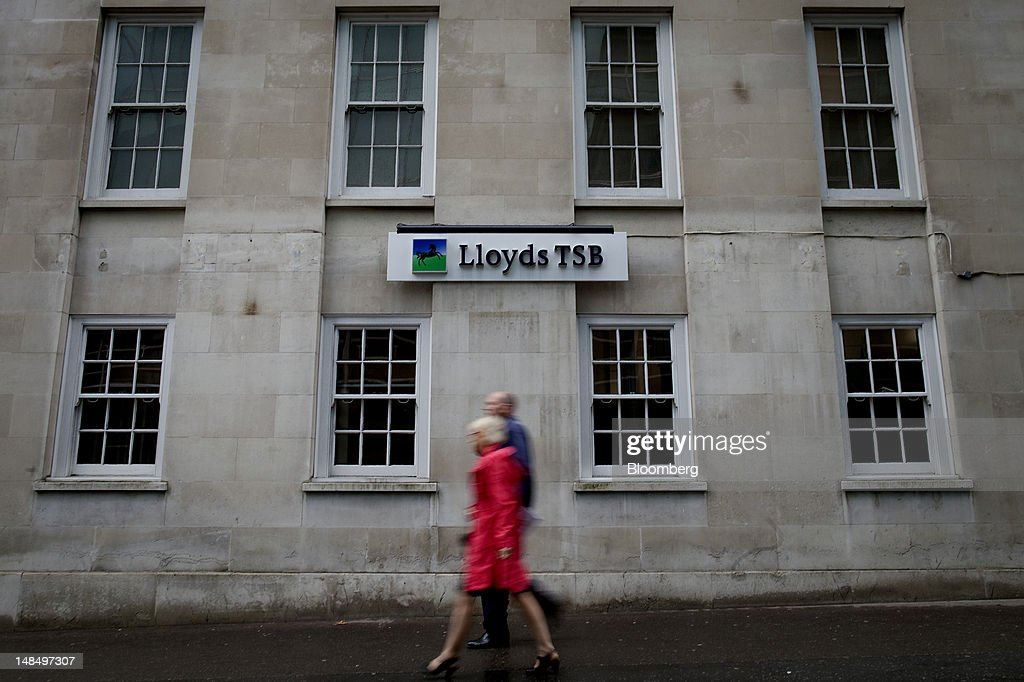 Pedestrians walk past a Lloyds TSB bank branch, part of the Lloyds Banking Group Plc, in London, U.K., on Wednesday, July 18, 2012. The U.K. financial regulator said it's investigating seven lenders over attempts to manipulate interbank offered rates as lawmakers criticized it for not opening the probe earlier. Photographer: Simon Dawson/Bloomberg via Getty Images