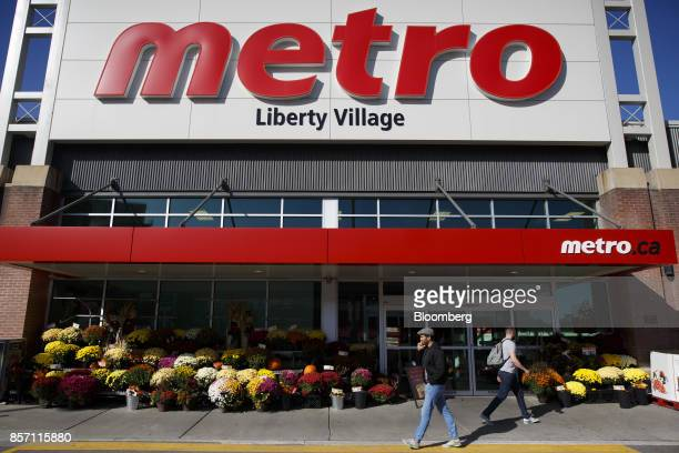 Pedestrians walk past a Metro Inc grocery store in Toronto Ontario Canada on Monday Oct 2 2017 Canadian grocer Metro Inc agreed to buy pharmacy chain...