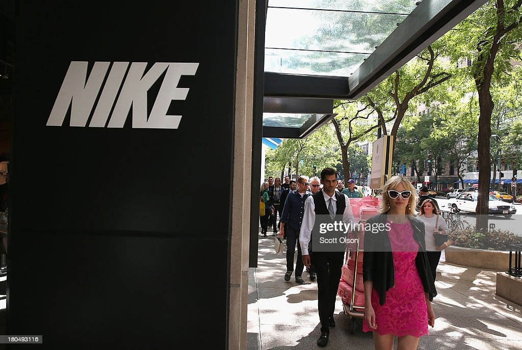 Pedestrians walk past a Nike store along the Magnificent Mile shopping district on September 13, 2013 in Chicago, Illinois. According to the Commerce Department retail sales rose a seasonally adjusted 0.2 percent in August from the previous month, short of the 0.5 percent anticipated by economists.