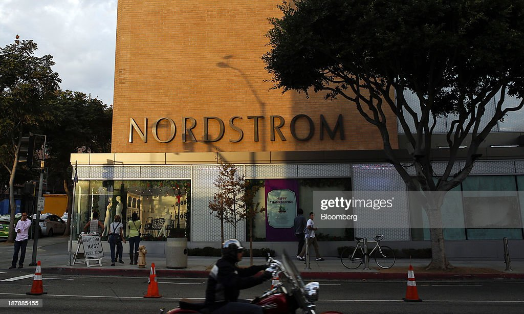Pedestrians walk past a Nordstrom Inc. department store in Santa Monica, California, U.S., on Tuesday, Nov. 12, 2013. Nordstrom Inc. is scheduled to release earnings figures on Nov. 14. Photographer: Patrick T. Fallon/Bloomberg via Getty Images