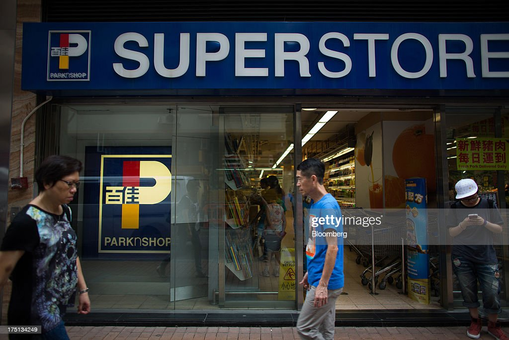 Pedestrians walk past a ParknShop Superstore supermarket, operated by Hutchison Whampoa Ltd., in Hong Kong, China, on Thursday, Aug. 1, 2013. KKR & Co., the private-equity firm run by Henry Kravis and George Roberts, is evaluating a bid for Hong Kong supermarket chain ParknShop, according to two people with knowledge of the matter. Hutchison is seeking $3 billion to $4 billion for the chain and has asked potential buyers to submit bids by Aug. 16, people with knowledge of the process have said. Photographer: Lam Yik Fei/Bloomberg via Getty Images