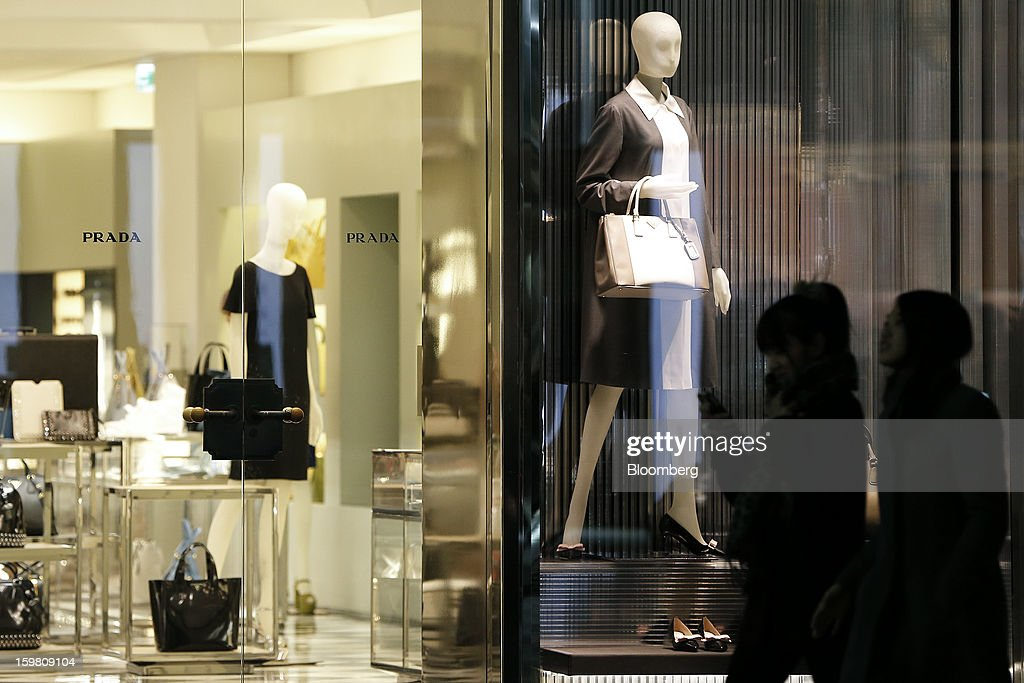 Pedestrians walk past a Prada SpA store in the Ginza district of Tokyo, Japan, on Sunday, Jan. 20, 2013. Japan's consumer prices excluding fresh food, a benchmark monitored by the central bank, haven't advanced 2 percent for any year since 1997, when a national sales tax was increased. Photographer: Kiyoshi Ota/Bloomberg via Getty Images
