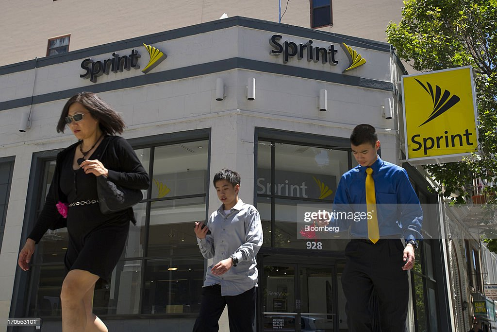 Pedestrians walk past a Sprint Nextel Corp. store in San Francisco, California, U.S., on Thursday, June 13, 2013. SoftBank Corp. Chief Executive Officer Masayoshi Son, seeking to expand into the U.S. wireless market, said he sees T-Mobile US Inc. as a 'Plan B' acquisition target if he fails to purchase Sprint Nextel Corp. Photographer: David Paul Morris/Bloomberg via Getty Images