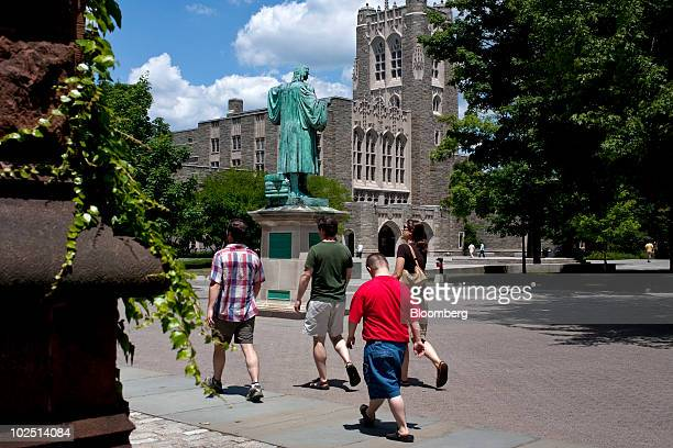 Pedestrians walk past a statue of former Princeton University president John Witherspoon near the Firestone Library on the school's campus in...