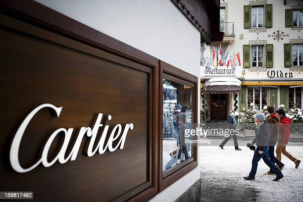 Pedestrians walk past a store advertising the Cartier jewelry brand in Gstaad Switzerland on Saturday Jan 19 2013 Options traders are pushing the...