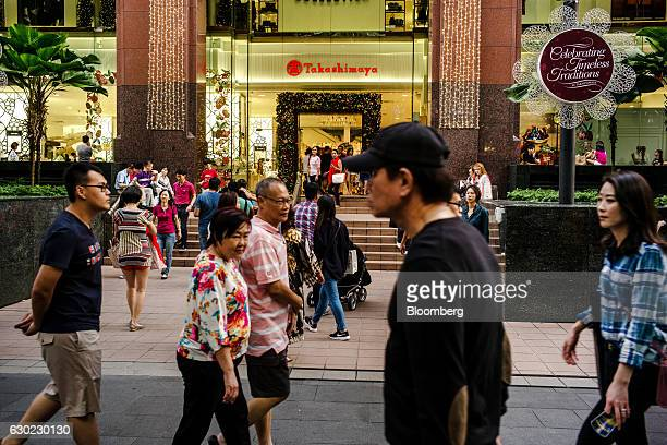 Pedestrians walk past a Takashimaya Co store on Orchard Road in Singapore on Sunday Dec 16 2016 Shopping has overtaken gambling as the biggest earner...
