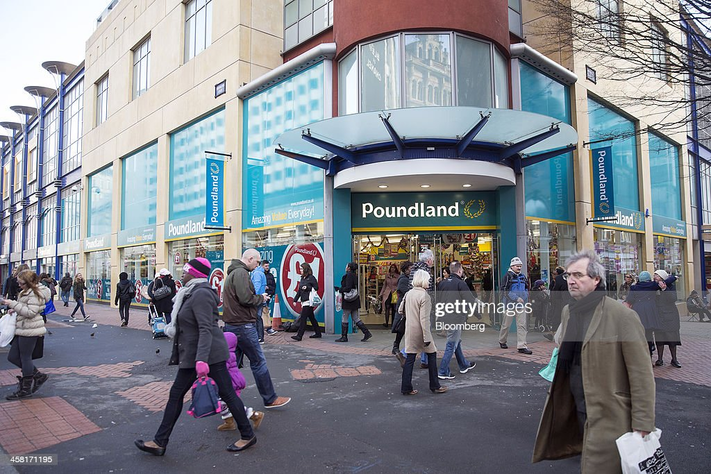 Pedestrians walk past a the entrance to Poundland discount store, operated by Poundland Holdings Ltd., in Birmingham, U.K., on Friday, Dec. 20, 2013. U.K. discount retailer Poundland has hired Rothschild to manage its IPO, according to the Sunday Times newspaper. Photographer: Simon Dawson/Bloomberg via Getty Images