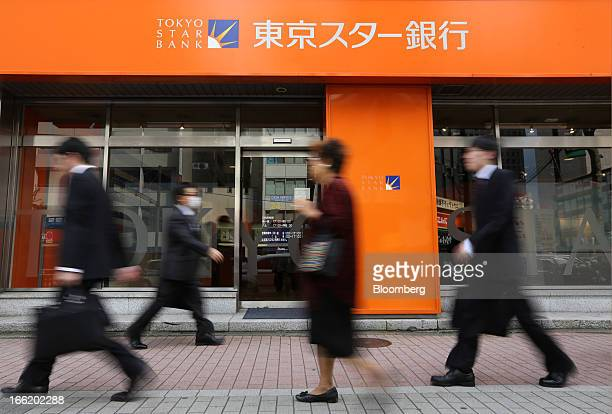 Pedestrians walk past a Tokyo Star Bank Ltd branch in Tokyo Japan on Wednesday April 10 2013 Taiwan's Chinatrust Financial Holding Co is seeking to...
