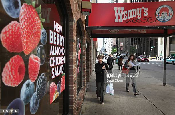 Pedestrians walk past a Wendy's restaurant on June 13 2011 in Chicago Illinois According to reports Wendy's/Arby's Group Inc will sell a majority...