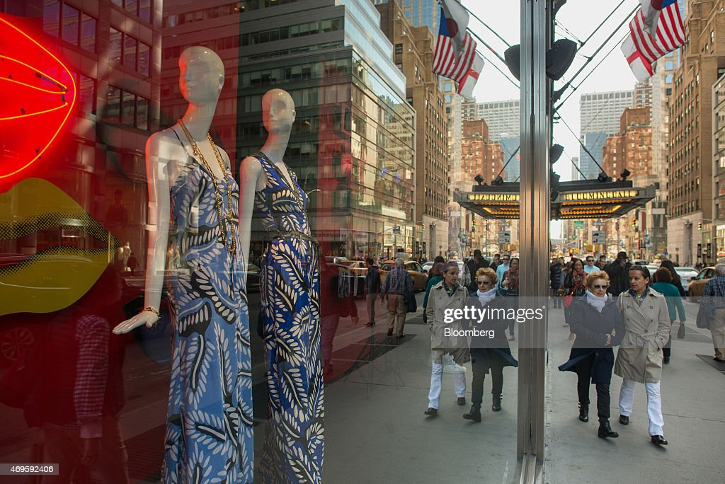 Pedestrians walk past a window display at a Bloomingdale's Inc store in New York US on Saturday April 11 2015 Retail sales figures will be released...