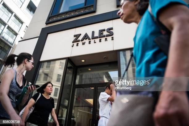 Pedestrians walk past a Zales Jewelers store in New York US on Wednesday August 23 2017 Mark Kauzlarich/Bloomberg via Getty ImagesSignet Jewelers Ltd...