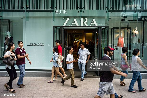 Pedestrians walk past a Zara store operated by Inditex SA in downtown Kuala Lumpur Malaysia on Sunday March 17 2013 Malaysia is scheduled to release...