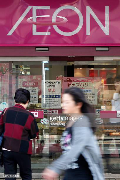 Pedestrians walk past an Aeon Co supermarket in Tokyo Japan on Thursday April 12 2012 Aeon Co Japan's largest supermarket operator reported...
