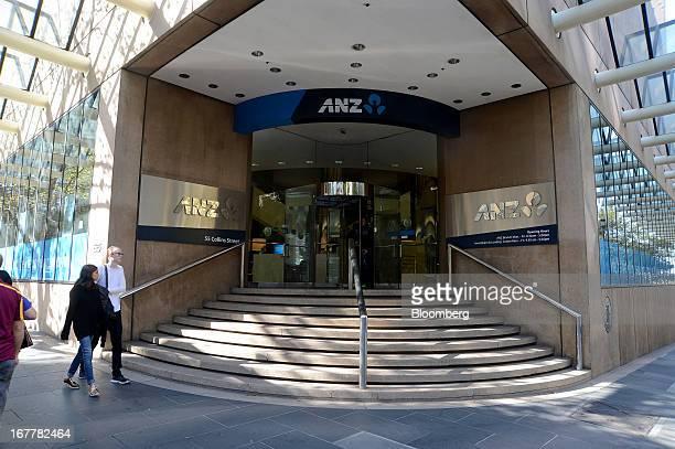 Pedestrians walk past an Australia New Zealand Banking Group Ltd bank branch in Melbourne Australia on Tuesday April 30 2013 Australia New Zealand...
