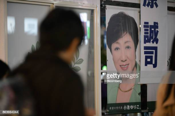 Pedestrians walk past an election campaign van featuring an image of Yuriko Koike governor of Tokyo and leader of the Party of Hope during an...