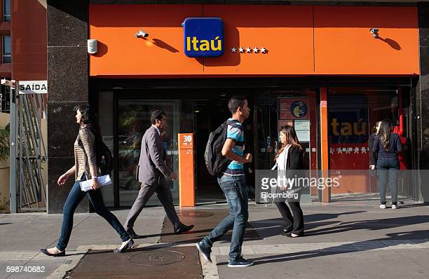 Pedestrians walk past an Itau Unibanco Holding SA bank branch in Sao Paulo Brazil on Thursday Sept 1 2016 Latin Americas largest economy shrank more...