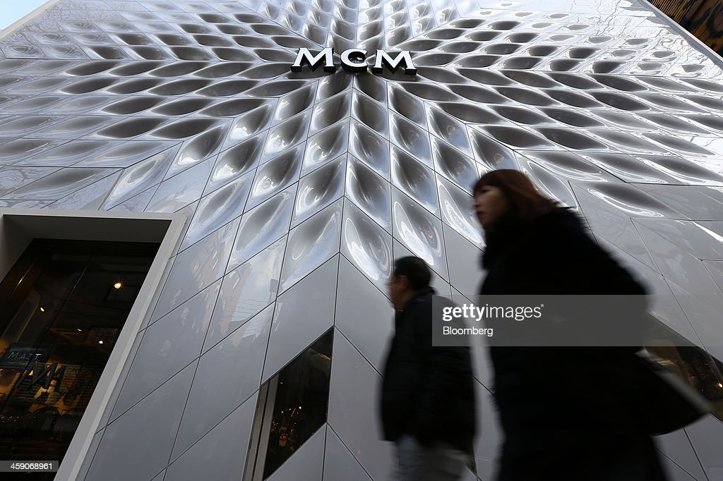Pedestrians walk past an MCM Holdings AG store on Garosugil street in the Gangnam district of Seoul, South Korea, on Sunday, Dec. 22, 2013. Consumer prices climbed 0.9 percent in November from a year earlier after a 0.7 percent increase in October that was the smallest gain since July 1999. Photographer: SeongJoon Cho/Bloomberg via Getty Images