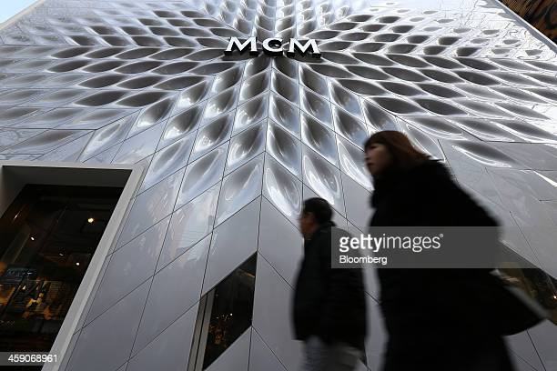 Pedestrians walk past an MCM Holdings AG store on Garosugil street in the Gangnam district of Seoul South Korea on Sunday Dec 22 2013 Consumer prices...