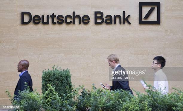 Pedestrians walk past an office of Deutsche Bank in London on August 28 2014 The German lender Deutsche Bank has been fined more than 47 million GBP...