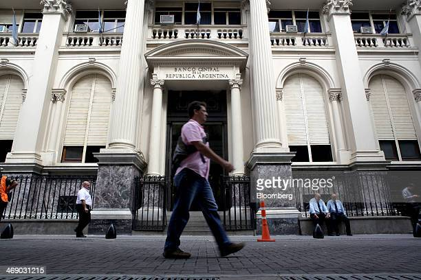 Pedestrians walk past Argentina's central bank in Buenos Aires Argentina on Wednesday Feb 12 2014 Argentina seeking to rebuild relations with foreign...