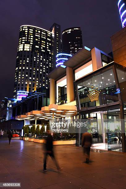 Pedestrians walk past Crown Resorts Ltd's Crown Melbourne casino and entertainment complex at night in Melbourne Australia on Friday Aug 7 2015 Crown...
