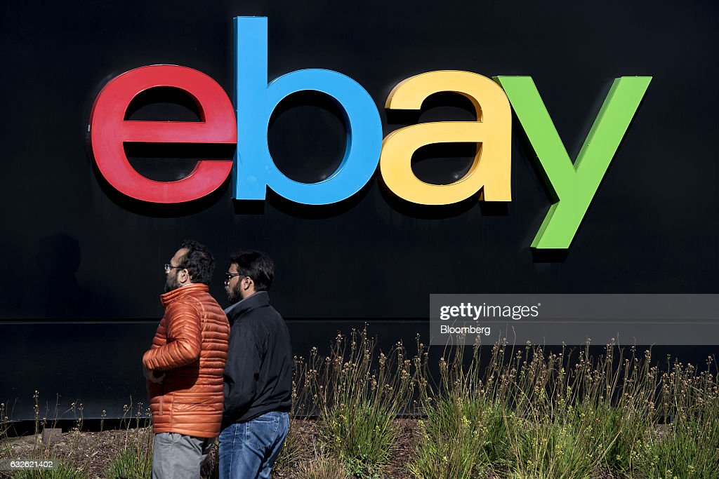 Pedestrians walk past eBay Inc. signage at the entrance to the company's headquarters in San Jose, California, U.S., on Tuesday, Jan. 24, 2017. Ebay is expected to release earnings figures on January 25. Photographer: David Paul Morris/Bloomberg via Getty Images