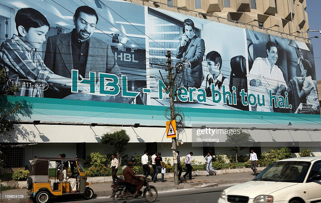 Pedestrians walk past Habib Bank Plaza, head office of Habib Bank Ltd., in the business and financial hub of Karachi, Pakistan, on Wednesday, Oct. 31, 2012. Businesses in Pakistan's commercial capital are bracing for a surge in extortion demands as parties representing the city's ethnic communities seek to use their hired guns to build financial war chests ahead of parliamentary polls due in the first half of next year. Photographer: Asim Hafeez/Bloomberg via Getty Images