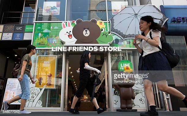 Pedestrians walk past Line Corp's LINE Friends Harajuku store on July 11 2016 in Tokyo Japan Japanese messaging app provider LINE Corp owned by South...