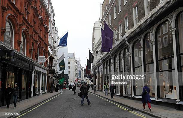 Pedestrians walk past luxury stores on New Bond Street in London UK on Wednesday Feb 29 2012 Bank of England Deputy Governor Charles Bean yesterday...