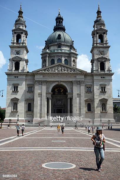 Pedestrians walk past St Stephen's Basilica in Budapest Hungary on Monday June 29 2009 Hungary's economic sentiment index rose in June to the highest...