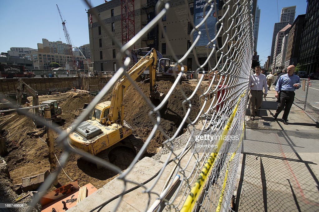 Pedestrians walk past the 307,000 square feet Boston Properties Inc. construction site on 535 Mission Street in San Francisco, California, U.S., on Wednesday, May 1, 2013. Leasing by San Francisco-area technology firms is slowing just as developers are poised to add 6.5 million square feet of office space to the city and Silicon Valley, the most construction in a dozen years. Photographer: David Paul Morris/Bloomberg via Getty Images