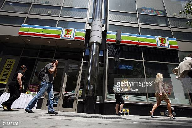 Pedestrians walk past the 711 store at 345 W 42nd Street converted into a KwikEMart from the longrunning television cartoon show 'The Simpsons' to...