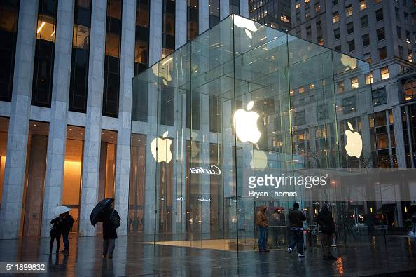 Pedestrians walk past the Apple store on 5th Avenue on February 23 2016 in New York City Protestors gathered to support Apple's decision to resist...