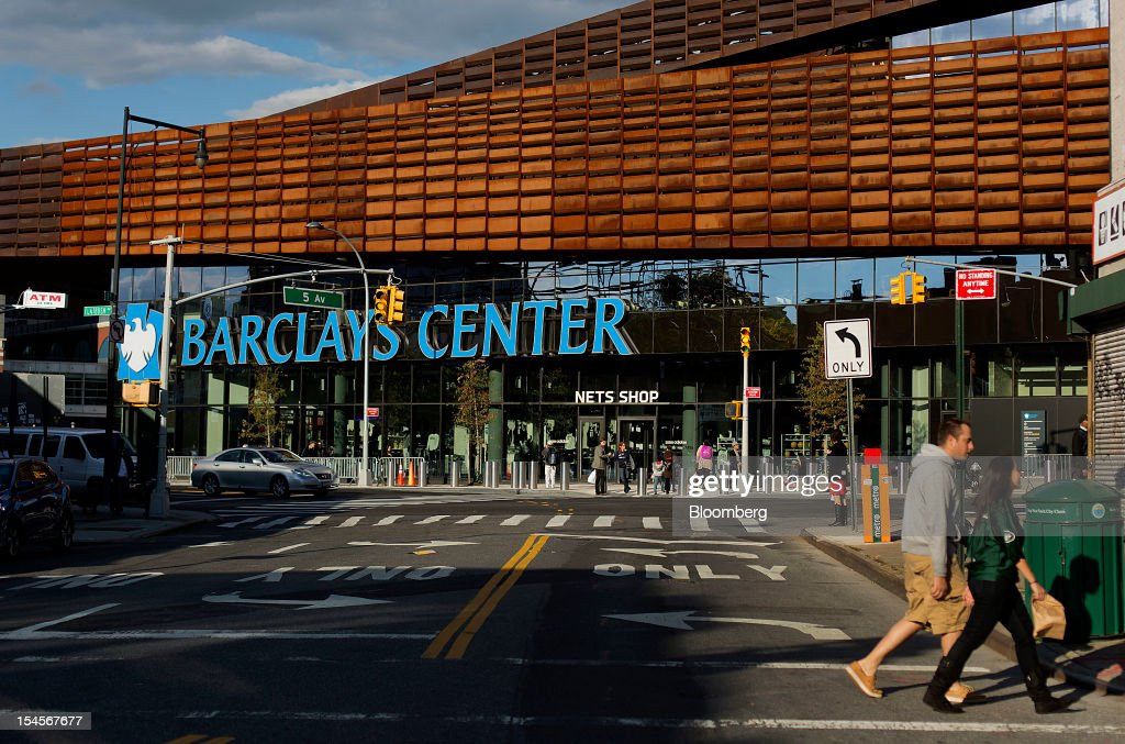 Pedestrians walk past the Barclays Center in the Brooklyn borough of New York, U.S., on Sunday, Oct. 21, 2012. The Barclays Center, the 675,000-square-foot arena designed by SHoP Architects PC of Manhattan, opened on Sept. 28 with eight sold-out shows by rapper Jay-Z. Photographer: Victor J. Blue/Bloomberg via Getty Images