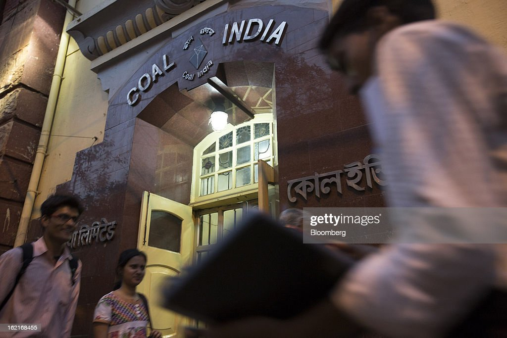 Pedestrians walk past the Coal India Ltd. headquarters in Kolkata, India, on Tuesday, Feb. 19, 2013. Coal India, the world's biggest producer of the fuel, has been grappling with stalled production growth for the past three years. Photographer: Brent Lewin/Bloomberg via Getty Images