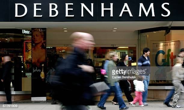 Pedestrians walk past the Debenhams store on Oxford St on April 9 2006 in London England Department store group Debenhams is considering a return to...
