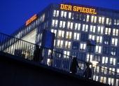 Pedestrians walk past the editorial offices of German news weekly Der Spiegel on December 7 2012 in Hamburg Germany Spiegel Verlag the publishing...