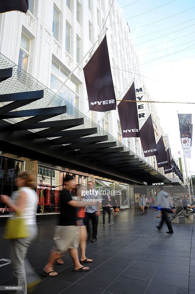 Pedestrians walk past the entrance to Myer Holdings Ltd.'s Melbourne City store in Melbourne, Australia, on Wednesday, March 13, 2013. Myer is scheduled to release company results on March 14. Photographer: Carla Gottgens/Bloomberg via Getty Images