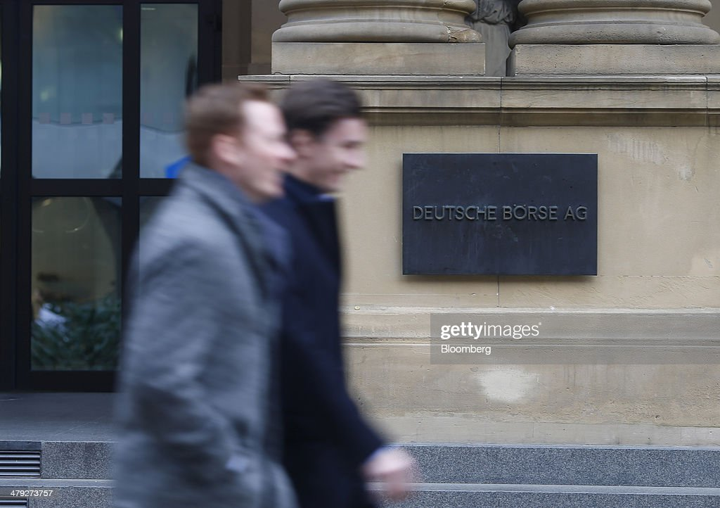 Pedestrians walk past the Frankfurt Stock Exchange in Frankfurt, Germany, on Monday, March 17, 2014. European stocks advanced, following their biggest weekly drop since January, as companies from RWE AG to Vodafone Group Plc rose amid renewed merger-and-acquisition activity. Photographer: Ralph Orlowski/Bloomberg via Getty Images
