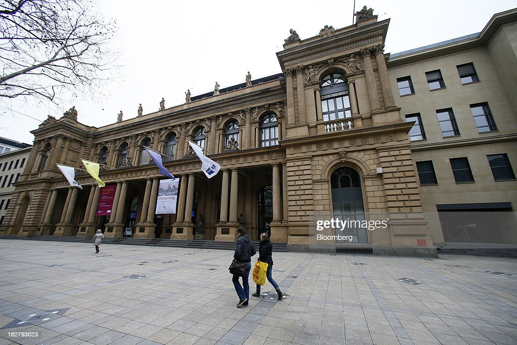Pedestrians walk past the front of the Frankfurt Stock Exchange in Frankfurt, Germany, on Tuesday, Feb. 27, 2013. Stocks rose, the euro strengthened from a seven-week low and Italian 10-year bonds gained after the country sold 6.5 billion euros ($8.5 billion) of debt amid political turmoil. Photographer: Ralph Orlowski/Bloomberg via Getty Images