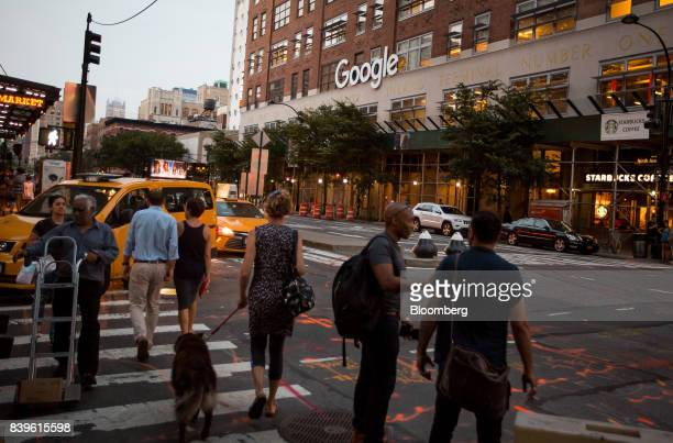 Pedestrians walk past the Google Inc offices in New York US on Tuesday Aug 22 2016 WalMart Stores Inc is teaming up with Google to let shoppers order...