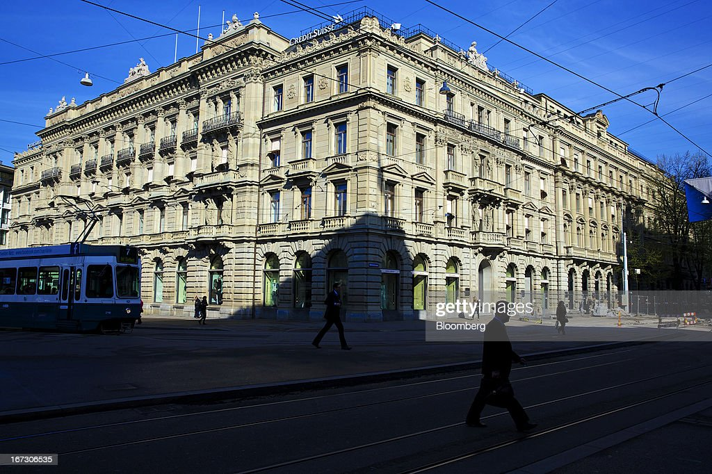 Pedestrians walk past the headquarters of Credit Suisse Group AG in Zurich, Switzerland, on Wednesday, April 24, 2013. Credit Suisse Group AG, the second-biggest Swiss bank, posted a jump in first-quarter profit as year-earlier charges related to its own debt and bonus payments weren't repeated. Photographer: Gianluca Colla/Bloomberg via Getty Images